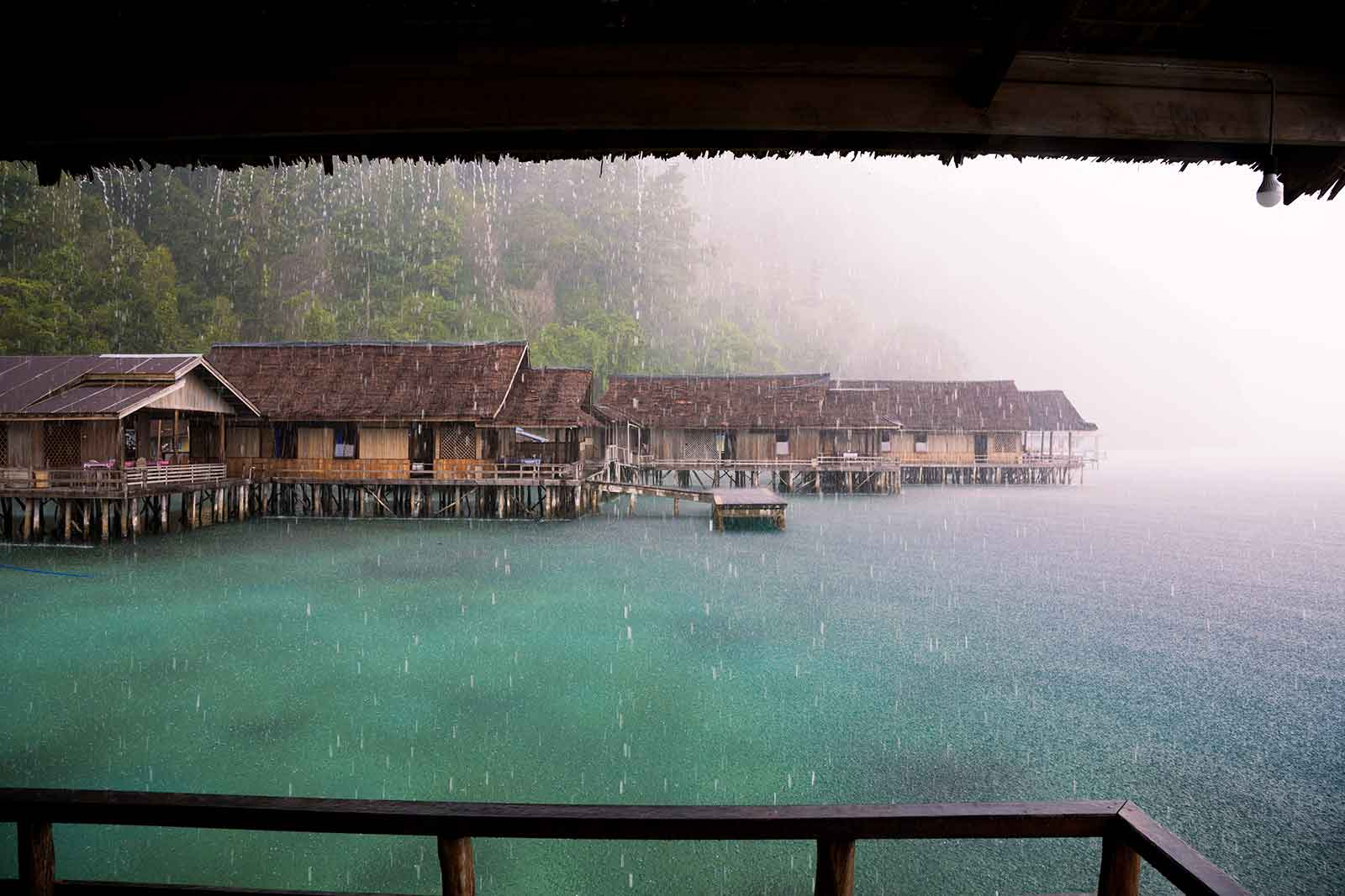 Maluku Islands: If you're visiting Indonesia during the rainy season, you'll have to face downpours like this quite often. Sometimes it rains for days, sometimes the rain stops just as fast as it came. Here we were at Lisar Bahari Resort in Sawai on Seram island and it was actually a mystical atmosphere being above the water with this heavy storm hitting us.